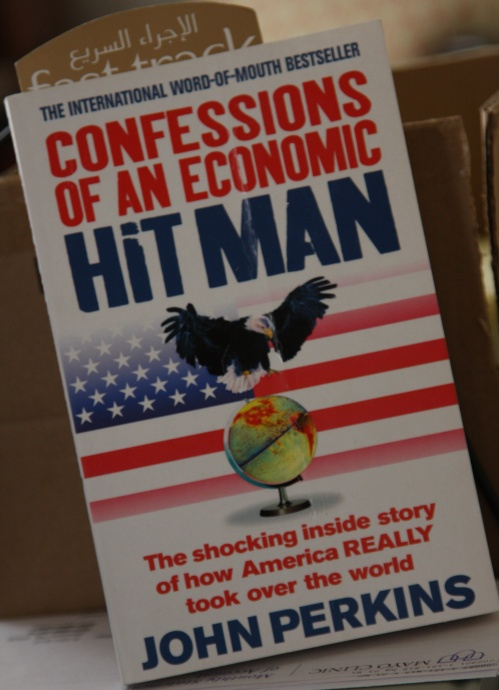 a review of confessions of an economic hit man by john perkins essay John perkins (born january 28, 1945) is an american authorhis best known book is confessions of an economic hit man (2004), in which perkins claims to have played a role in an alleged process of economic colonization of third world countries on behalf of what he portrays as a cabal of corporations, banks, and the united states government.